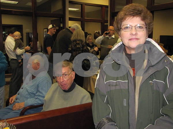 Barb Pessica and her father Clarence (seated) attended Northwest Bank's holiday open house.