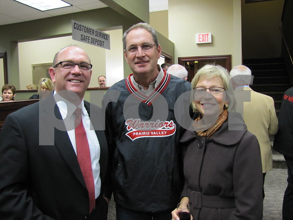John Taets, President of Northwest Bank, poses with Larry and Jill Alliger at the bank's holiday open house.