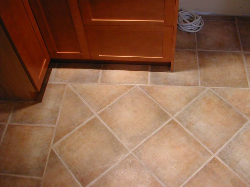 Tilework on kitchen floor and new cabinets