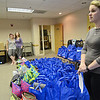 Katelyn Manning, a teacher at St. Anna's in Leominster, speaks to the crowd after Help for Our Communities, a Fitchburg-based charity group, delivered supply bags for children placed in emergency foster care to the DCF office in Leominster on Tuesday evening. SENTINEL & ENTERPRISE / Ashley Green
