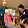 D'Youville Life and Wellness Community president & CEO, with memory care unit resident Angelina Freitas, 93, and her daughter Diana Vario of Nashua.  (SUN/Julia Malakie)