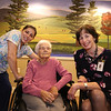 D'Youville Life and Wellness Community president & CEO,  with memory care unit resident Angelina Freitas, 93, and CNA Jessica Torres of Lowell, who works with Freitas.  (SUN/Julia Malakie)
