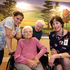 D'Youville Life and Wellness Community president & CEO,  with memory care unit resident Angelina Freitas, 93, her daughter Diana Vario of Nashua, and CNA Jessica Torres of Lowell, left, who works with Freitas.  (SUN/Julia Malakie)