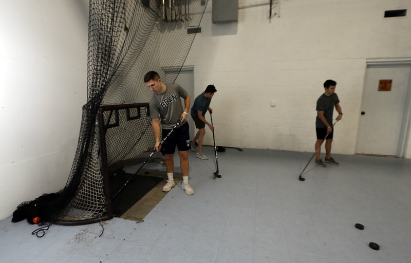 Danvers Indoor Sports expands into Wilmington with this recently purchased facility on Upton Drive. From left, Jack Studley of Billerica, Trey Deloury of Andover, and Patrick Rossetti of Melrose, all members of the Valley Junior Warriors hockey team out of Haverhill, collect pucks as they practice slap shots.  (SUN/Julia Malakie)