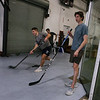 Danvers Indoor Sports expands into Wilmington with this recently purchased facility on Upton Drive. Jack Studley of Billerica, left, Trey Deloury of Andover, right, and Patrick Rossetti of Melrose, rear, all members of the Valley Junior Warriors hockey team out of Haverhill, practice slap shots.  (SUN/Julia Malakie)