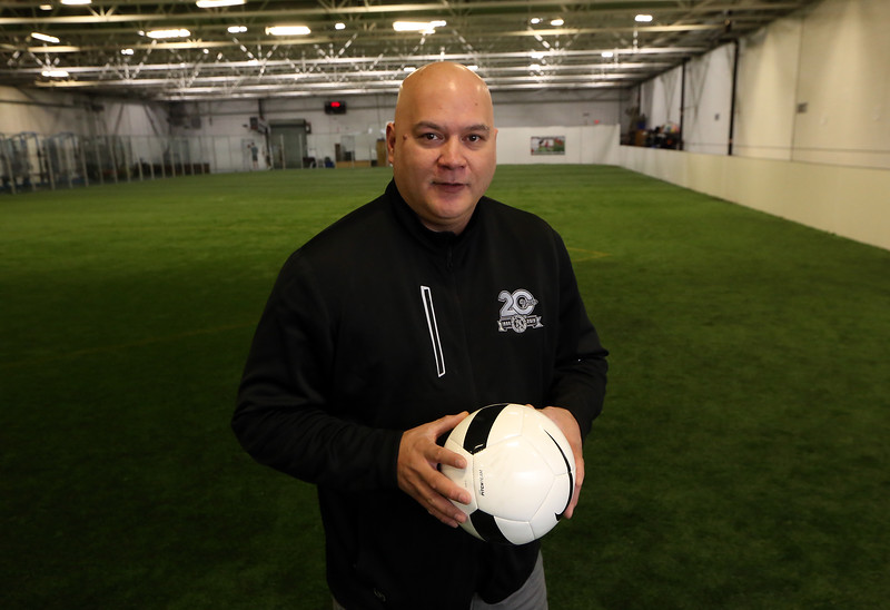 Danvers Indoor Sports expands into Wilmington with this recently purchased facility on Upton Drive. Owner Kelly Cragg of Danvers, at the indoor turf field.(SUN/Julia Malakie)