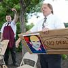 Richard Garneau, a baker, and Bill Fuller, Head Baker, protest outside the Market Basket store in Leominster on Tuesday afternoon. SENTINEL & ENTERPRISE / Ashley Green