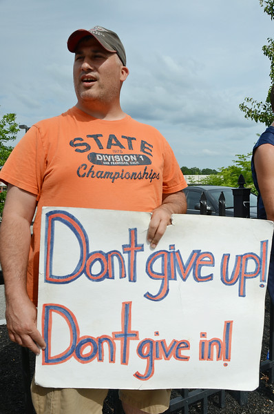 Greg Belleza, Front End Manager, continues protests outside the Market Basket store on Water Street in Fitchburg on Tuesday afternoon. SENTINEL & ENTERPRISE / Ashley Green