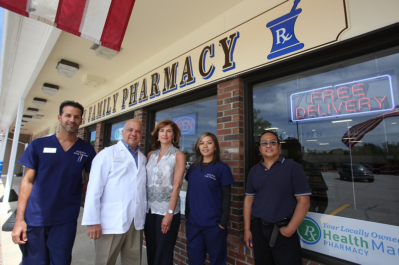 Health Care Family Pharmacy, run by two of its three owners, Sam and wife Connie Hantzis of Lowell, is now open at Loon Hill Road and Rt 113 in Dracut. From left, pharmacy technician Orlando Rivera, owners Sam and Connie Hantzis, lead technician Tiffany Nanthavong, and delivery driver Ruben Arroco, all of Lowell. (Not present: staff pharmacist Lisa Gray.) (SUN/Julia Malakie)