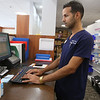 Health Care Family Pharmacy, an independent pharmacy, is now open at Loon Hill Road and Rt 113 in Dracut. Pharmacy technician Orlando Rivera at computer. (SUN/Julia Malakie)