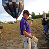 "Pilot Michael Gianetti of Life Cycle Balloon Adventures sets up his balloon as Barbara Patrick assists before a passenger flight  in the Gunbarrel area of Boulder on Thursday morning. <br /> FOR MORE PHOTOS AND A VIDEO OF THE LIFTOFF GO TO  <a href=""http://WWW.DAILYCAMERA.COM"">http://WWW.DAILYCAMERA.COM</a> <br /> Photo by Paul Aiken / The Camera / 8/ 18/ 2011"