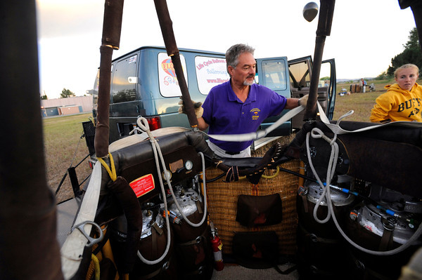 "Michael Gianetti, pilot for Life Cycle Balloon Adventures prepares for a morning flight in the Gunbarrel area of Boulder on Thursday morning. FOR MORE PHOTOS AND A VIDEO OF THE LIFTOFF GO TO  <a href=""http://WWW.DAILYCAMERA.COM"">http://WWW.DAILYCAMERA.COM</a> <br /> Photo by Paul Aiken / The Camera / 8/ 18/ 2011"