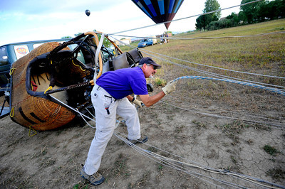 Pilot Michael Gianetti of Life Cycle Balloon Adventures sets up his balloon before a passenger flight  in the Gunbarrel area of Boulder on Thursday morning.  FOR MORE PHOTOS AND A VIDEO OF THE LIFTOFF GO TO WWW.DAILYCAMERA.COM  Photo by Paul Aiken / The Camera / 8/ 18/ 2011