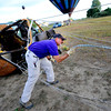 "Pilot Michael Gianetti of Life Cycle Balloon Adventures sets up his balloon before a passenger flight  in the Gunbarrel area of Boulder on Thursday morning. <br /> FOR MORE PHOTOS AND A VIDEO OF THE LIFTOFF GO TO  <a href=""http://WWW.DAILYCAMERA.COM"">http://WWW.DAILYCAMERA.COM</a> <br /> Photo by Paul Aiken / The Camera / 8/ 18/ 2011"
