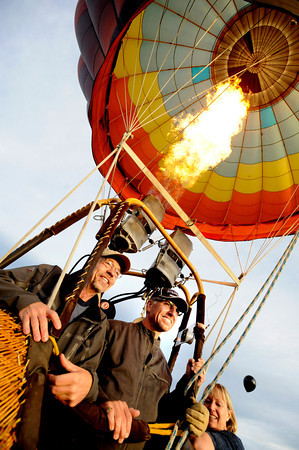 "Passengers George Emmons, left and Scott Shevlin, get their photo taken before their flight with Life Cycle Balloon Adventures in the Gunbarrel area of Boulder on Thursday morning. <br /> FOR MORE PHOTOS AND A VIDEO OF THE LIFTOFF GO TO  <a href=""http://WWW.DAILYCAMERA.COM"">http://WWW.DAILYCAMERA.COM</a> <br /> Photo by Paul Aiken / The Camera / 8/ 18/ 2011"
