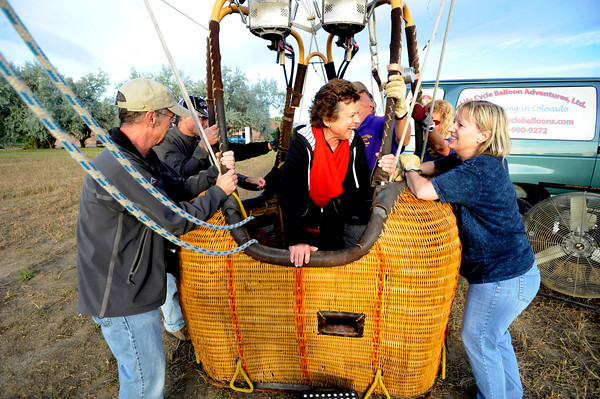 "Anne Schiferl laughs with Life Cycle Balloon Adventures Barbara Patrick at right after she struggled to get into the balloon basket before her flight in the Gunbarrel area of Boulder on Thursday morning. Holding onto the balloon at left is passenger George Emmons.<br /> FOR MORE PHOTOS AND A VIDEO OF THE LIFTOFF GO TO  <a href=""http://WWW.DAILYCAMERA.COM"">http://WWW.DAILYCAMERA.COM</a> <br /> Photo by Paul Aiken / The Camera / 8/ 18/ 2011"
