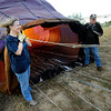 "Barbara Patrick, left, with  Life Cycle Balloon Adventures gets help from passenger Gene Schiferl before his fiight in the Gunbarrel area of Boulder on Thursday morning. <br /> FOR MORE PHOTOS AND A VIDEO OF THE LIFTOFF GO TO  <a href=""http://WWW.DAILYCAMERA.COM"">http://WWW.DAILYCAMERA.COM</a> <br /> Photo by Paul Aiken / The Camera / 8/ 18/ 2011"