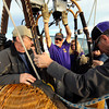 "Passengers George Emmons, left waits as Scott Shevlin climbs into the basket as pilot Michael Gianetti, of Life Cycle Balloon Adventures, organizes the balloon for liftoff in the Gunbarrel area of Boulder on Thursday morning. <br /> FOR MORE PHOTOS AND A VIDEO OF THE LIFTOFF GO TO  <a href=""http://WWW.DAILYCAMERA.COM"">http://WWW.DAILYCAMERA.COM</a> <br /> Photo by Paul Aiken / The Camera / 8/ 18/ 2011"