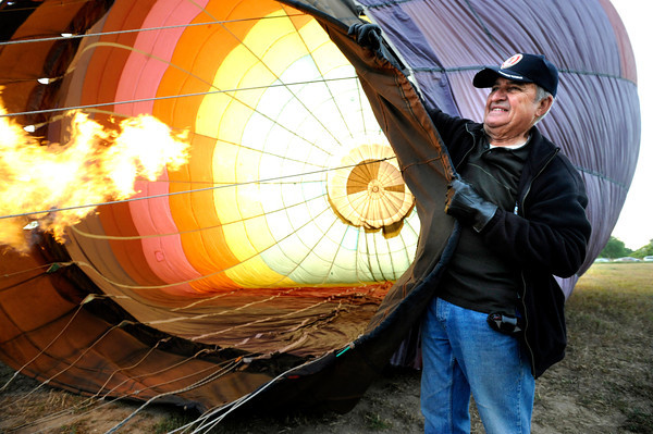 "Gene Schiferl helps get the balloon ready before his fiight with Life Cycle Balloon Adventures in the Gunbarrel area of Boulder on Thursday morning. <br /> FOR MORE PHOTOS AND A VIDEO OF THE LIFTOFF GO TO  <a href=""http://WWW.DAILYCAMERA.COM"">http://WWW.DAILYCAMERA.COM</a> <br /> Photo by Paul Aiken / The Camera / 8/ 18/ 2011"