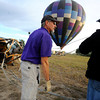 "Pilot Michael Gianetti, left,  of Life Cycle Balloon Adventures gives instructions to passenger Gene Schiferl who volunteered to help set up the balloon before a  flight  in the Gunbarrel area of Boulder on Thursday morning. <br /> FOR MORE PHOTOS AND A VIDEO OF THE LIFTOFF GO TO  <a href=""http://WWW.DAILYCAMERA.COM"">http://WWW.DAILYCAMERA.COM</a> <br /> Photo by Paul Aiken / The Camera / 8/ 18/ 2011"