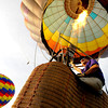 "Pilot Michael Gianetti of Life Cycle Balloon Adventures guides his balloon up at liftoff of a passenger flight  in the Gunbarrel area of Boulder on Thursday morning. <br /> FOR MORE PHOTOS AND A VIDEO OF THE LIFTOFF GO TO  <a href=""http://WWW.DAILYCAMERA.COM"">http://WWW.DAILYCAMERA.COM</a> <br /> Photo by Paul Aiken / The Camera / 8/ 18/ 2011"
