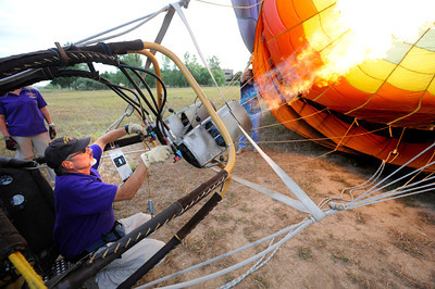 Pilot Michael Gianetti of Life Cycle Balloon Adventures fires up the burners before a passenger flight  in the Gunbarrel area of Boulder on Thursday morning.  FOR MORE PHOTOS AND A VIDEO OF THE LIFTOFF GO TO WWW.DAILYCAMERA.COM  Photo by Paul Aiken / The Camera / 8/ 18/ 2011