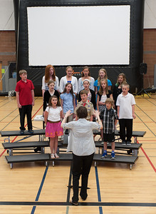Choir instructor Rebecca Webber leading a group in song.