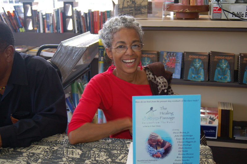 Author S. Pearl signs her latest work The Healing Passage.