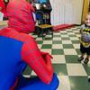 Kayden Smith, 2, checks out Spiderman (Matthew Saindon) during Espresso Pizza's 50th anniversary celebration on Saturday afternoon. SENTINEL & ENTERPRISE / Ashley Green
