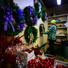 Kristin Manix, a manager of Elysian Hills Tree Farm,  works on a variety of holiday wreaths.