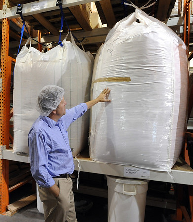 "Jarrett Eggers, the General Manager of Fiona's Granola, shows one of the giant bags of grain.<br /> For more photos of Fiona's, go to  <a href=""http://www.dailycamera.com"">http://www.dailycamera.com</a>.<br />  Cliff Grassmick / July 19, 2012"