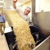 "Baker, Adam Chirikos, makes a batch of Fiona's Granola at the Longmont location.<br /> For more photos of Fiona's, go to  <a href=""http://www.dailycamera.com"">http://www.dailycamera.com</a>.<br />  Cliff Grassmick / July 19, 2012"
