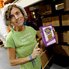 "Fiona Simon, founder of Fiona's Granola, holds one of her favorite products, the almond crunch.<br /> For more photos of Fiona's, go to  <a href=""http://www.dailycamera.com"">http://www.dailycamera.com</a>.<br />  Cliff Grassmick / July 19, 2012"
