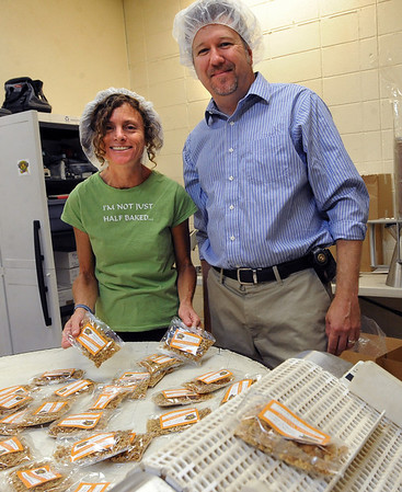 "Fiona Simon, founder of Fiona's Granola, and Jarrett Eggers, General Manager, are pictured with some of the sample products.<br /> For more photos of Fiona's, go to  <a href=""http://www.dailycamera.com"">http://www.dailycamera.com</a>.<br />  Cliff Grassmick / July 19, 2012"
