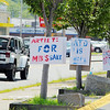 Signs hang on trees out in from of the Market Basket on John Fitch Highway in Fitchburg in support for ousted CEO Arthur T. Demoulas reinstated on Tuesday morning. SENTINEL & ENTERPRISE/JOHN LOVE