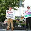Holding Employees Rachael Lanson, 23, and Steve Donahue, 25, hold signs at the Market Basket near the Mall at Whitney Field in Leominster in support for ousted CEO Arthur T. Demoulas to be reinstated on Tuesday morning. SENTINEL & ENTERPRISE/JOHN LOVE