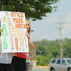 """Point of Sales Coordinator Danielle Breitenwischer at the Market Basket on John Fitch Highway in Fitchburg holds a sign with a giraffe on it symbolizing that the works are """"sticking there necks out"""" for ousted CEO Arthur T. Demoulas reinstated.  SENTINEL & ENTERPRISE/JOHN LOVE"""