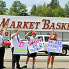 Many employees at the Market Basket on John Fitch Highway in Fitchburg holded  signs in support for ousted CEO Arthur T. Demoulas reinstated on Tuesday morning.  SENTINEL & ENTERPRISE/JOHN LOVE