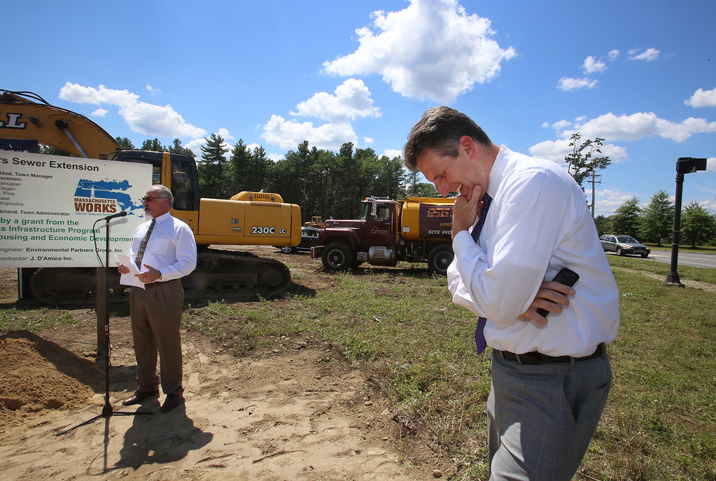 . Groundbreaking ceremony for the Four Corners MassWorks Infrastructure Project, at the intersection of Rt 119 and Rt 225 in Groton. Massachusetts Executive Office of Housing and Economic Development secretary Jay Ash, right, reacts to a remark by Groton town manager Mark Haddad, left. (SUN/Julia Malakie)