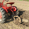 Joe's Farmall Cub pulls the one-bottom plow through the rich bottomland of Full Circle Farm on March 12, 2010.