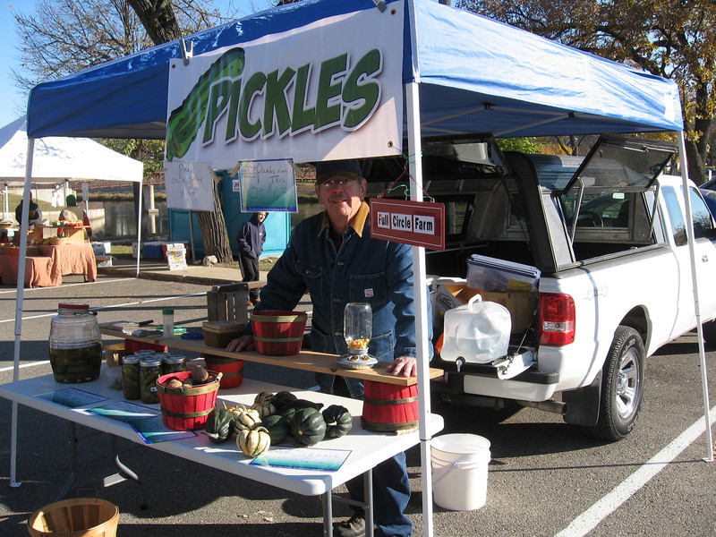 Joe selling produce on last  day of Summer (outdoors) Rochester Downtown Farmers Mrket