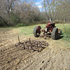 The Farmall Be pulls a drag harrow (digger) to get the land ready for planting garlic. Oct. 10, 2012.