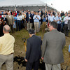 A large crowd was gathered around as the GTI and government officials congratulate each other after breaking ground for the new auto parts plant.