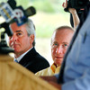 GTI executive vice president William LaFramboise and Governor Mitch Daniels listen to Anderson Mayor Kevin Smith during the groundbreaking for Greenville Technology Inc. new auto parts plant.