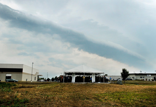 The groundbreaking program for Greenville Technology Inc. new auto parts plant Tuesday morning was hurried along as threatening skies loomed overhead.