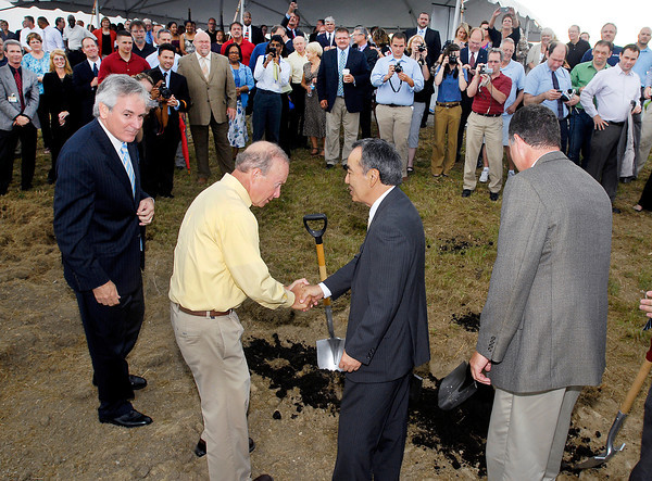 Indiana Governor Mitch Daniels, second from left, congratulates Hiroyasu Masuno, third from left, director North America Operation for Moriroku Technology North America, as William LaFramboise, left, executive vice president GTI, and Tom Moore, right, vice president GTI, look on after they broke ground for their new auto parts plant.