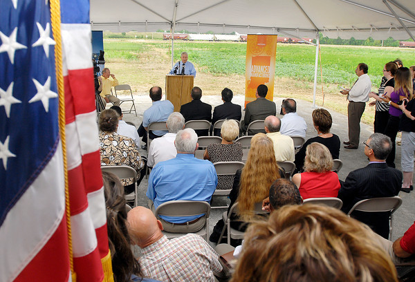 Anderson Mayor Kevin Smith addresses those gathered for the <br /> groundbreaking of Greenville Technology Inc. new auto parts plant at the Flagship.