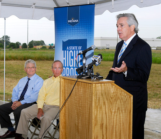 Anderson Mayor Kevin Smith and Indiana Governor Mitch Daniels listen as William LaFramboise, executive vice president for Greenville Technology Inc., makes the official announcement of GTI building a 150,000 square-foot auto parts manufacturing plant in the Flagship Business Park.