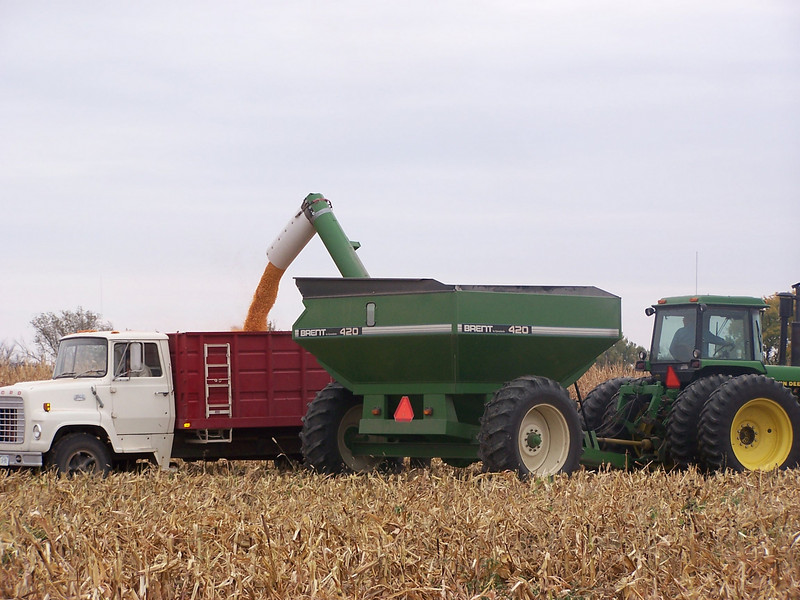 Trucks and Combine used in gathering the Harvest.
