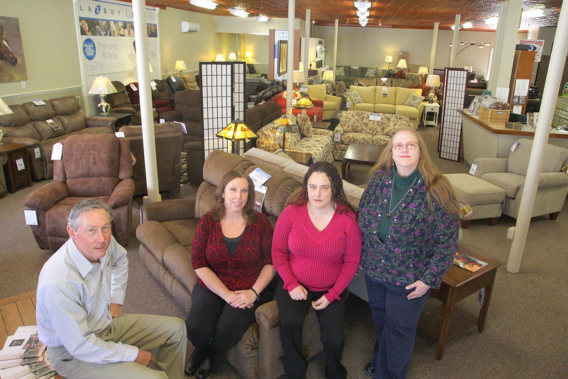 Gariepy Furniture  & Mattress Center in Leominster has reopened it's doors on Thursday will all new inventory. They had to get rid of everything do to a fire three months ago. They where only closed for a day but were without furniture for about a month. You can see all of the new furniture behind owner Steve Gariepy and his employees, from left, Ann Marsh, Jessica Oothoudt and Christine Van Hillo-Babineau. SENTINEL & ENTERPRISE/JOHN LOVE